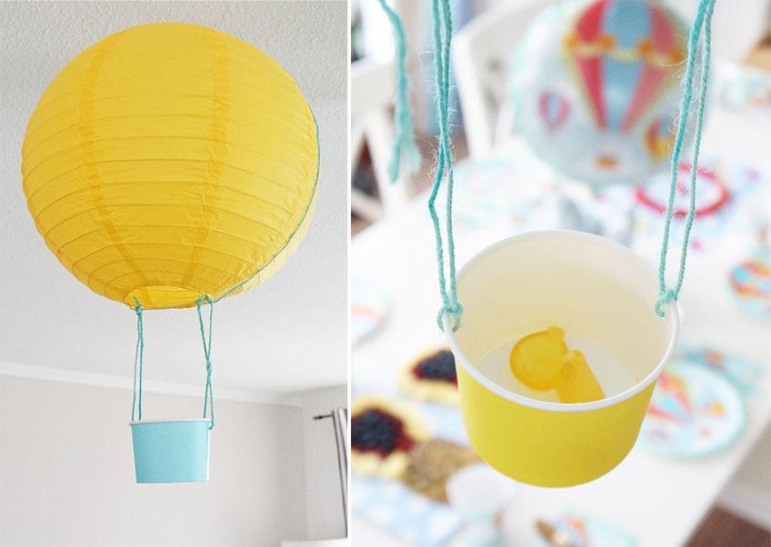 Heißluftballon mit einem Eisbecher zum Befüllen