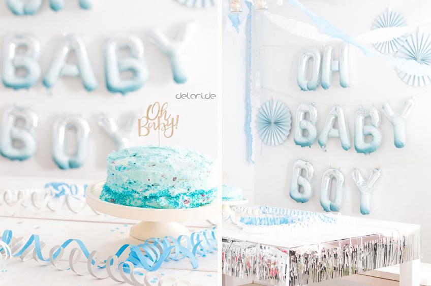 Mit etwas blauer Farbe werden eure Folienballons zu wunderschönen Hinguckern auf eurer Jungen-Babyparty. Foto: delari.de