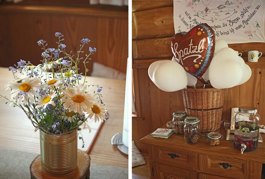 Wildblumen, Blechdosen-Vasen, Einmachgläser und viele Holz-Elemente zur Taufe im Landhausstil