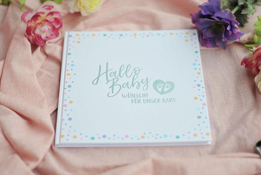 Sammle gute Wünsche in einem süßen Gästebuch als Babyparty-Geschenk