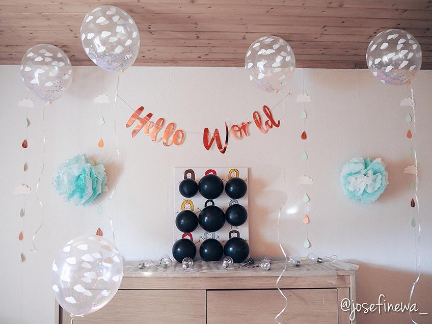 Gender Reveal mit Darts - ein Ballon enthält pinkes oder blaues Konfetti (c) josefinewa