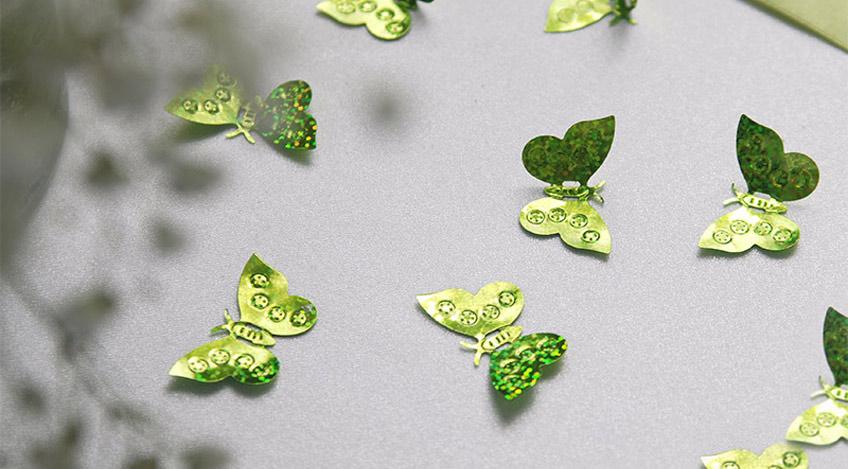 Lasse kleine grüne Schmetterlinge auf deine Taufe fliegen!