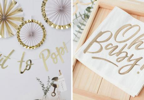 Papierfächer, Girlanden und Servietten für eine Babyparty mit Gold-Akzenten