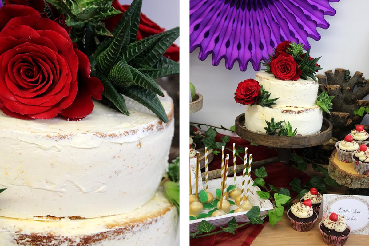 Die weiße Torte mit Rosendeko ist ein Hingucker auf dem märchenhaften Sweet Table