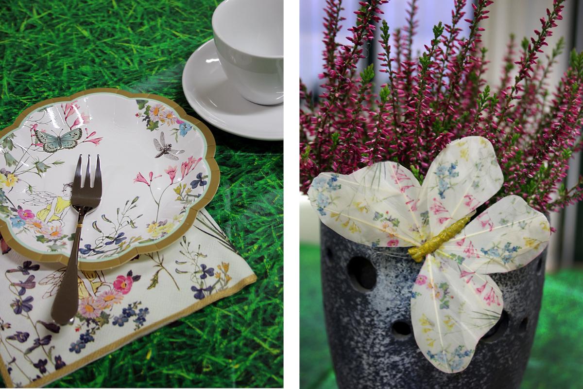 Teller im Schmetterlingsdesign und Schmetterlingen schmücken den märchenhaften Tisch