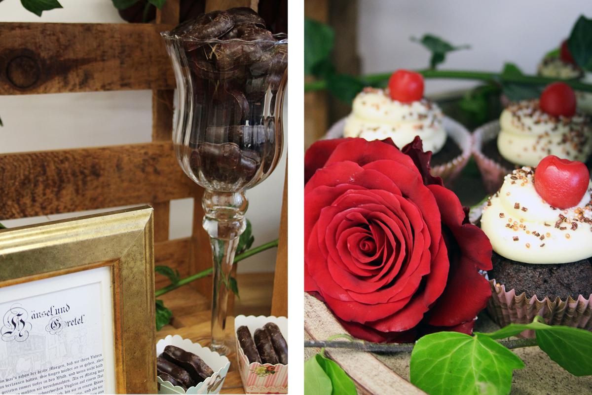 Rote Rosen und ein Glas mit verzaubertem Inhalt machen den Sweet Table zu einem Teil der märchenhaften Babyparty