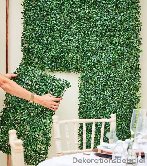 Wanddekoration mit grünen Kunstblättern - 40 x 60 cm